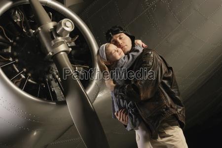 pilot hugging child