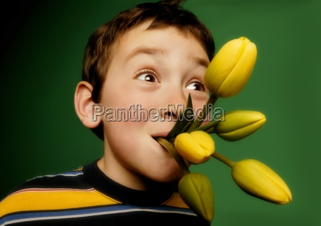 boy with flowers in his mouth