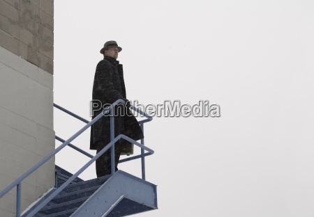 lone man standing on an outdoor