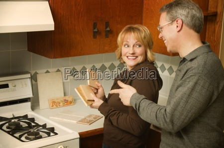 couple choosing tile for kitchen