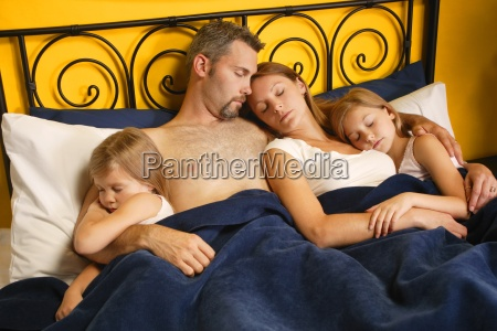 a young family taking a nap