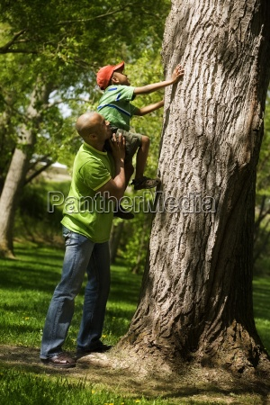 father helping son to climb on