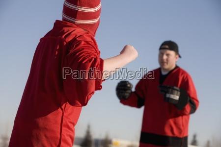 ice hockey players fighting