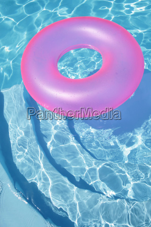 pink ring floating in a blue