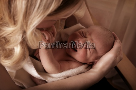 mother soothing a crying baby