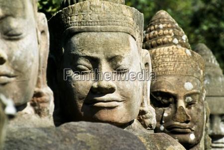 head statues angkor thom cambodia