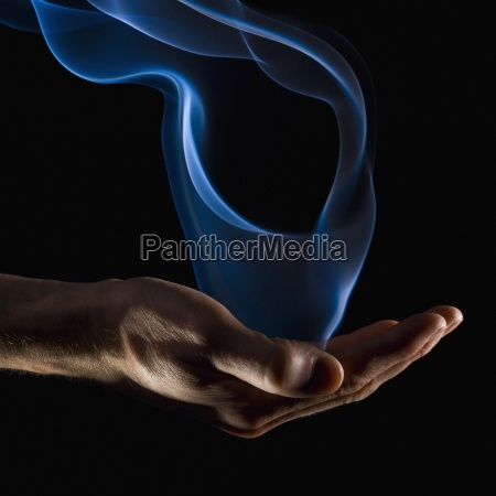 smoke wisps from a hand