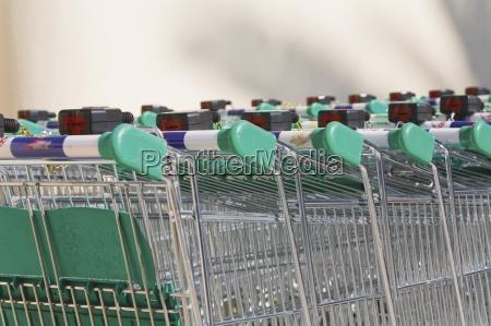 shopping carts rows of shopping trolleys