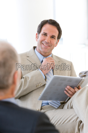 business finance person reading people work