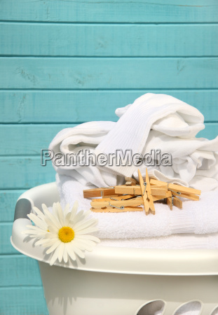 white basket with laundry
