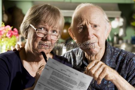 elder, couple, with, bills - 2202395