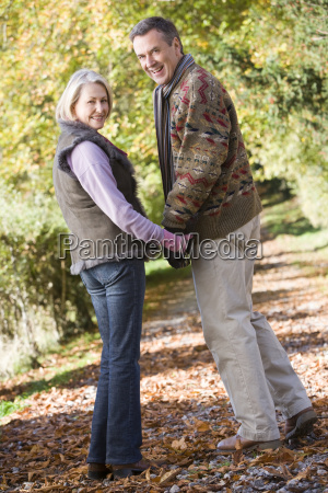couple outdoors on path in park