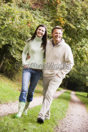 couple walking outdoors on path in