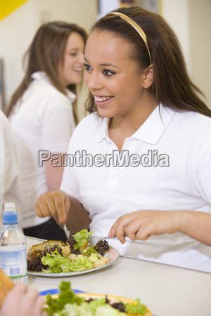 student having lunch in dining hall