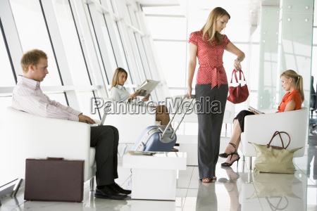 female airline passenger waiting with other
