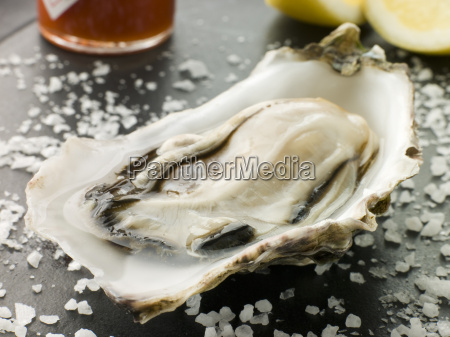 opened rock oyster with hot chilli