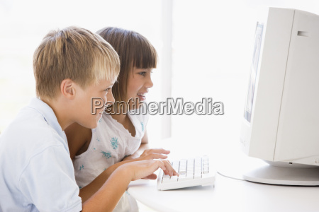 two young children in home office