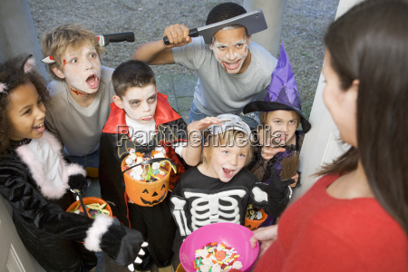 six children in costumes trick or