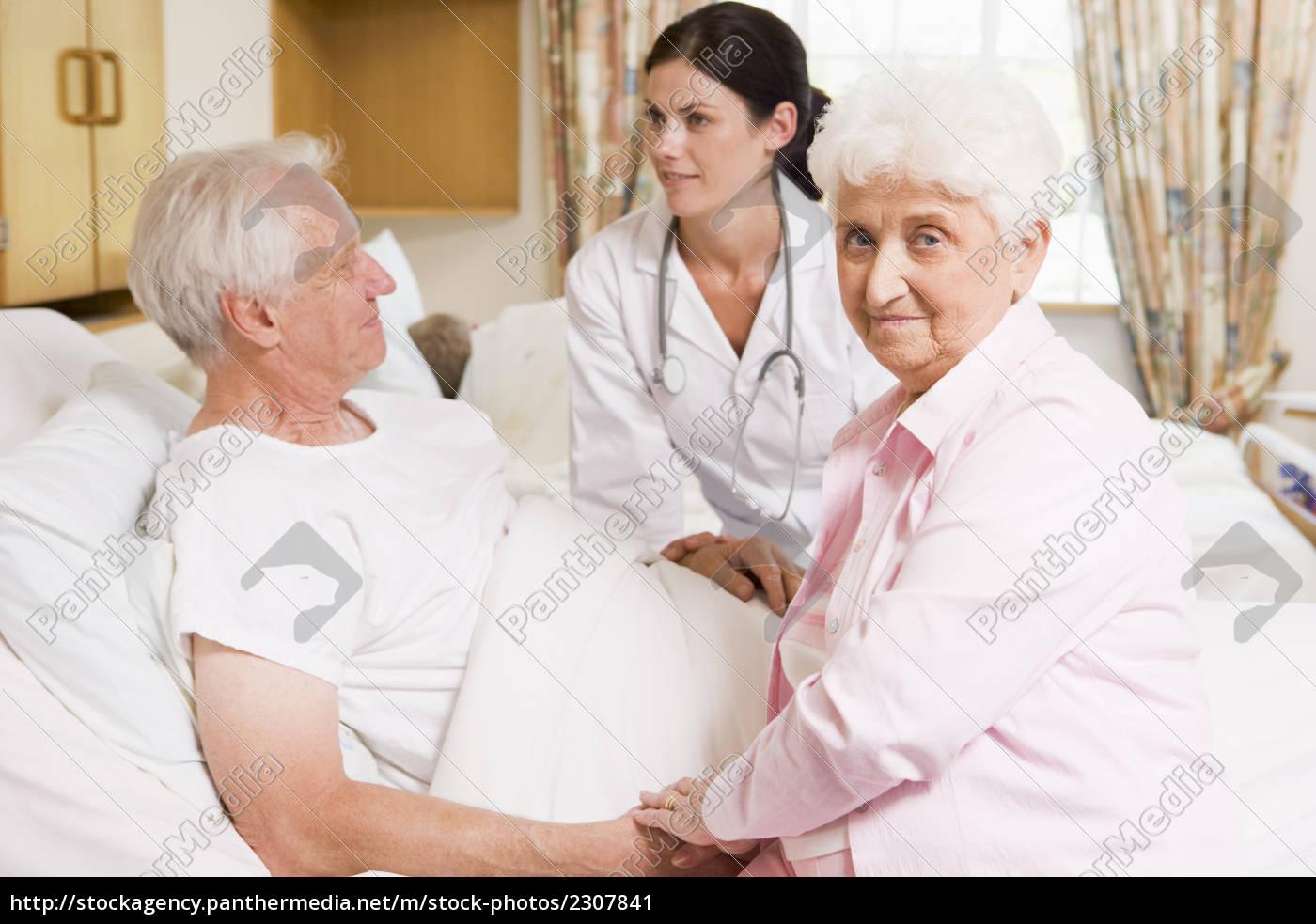 doctor, talking, to, senior, couple - 2307841