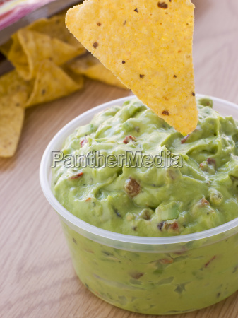 pot of guacamole with a corn