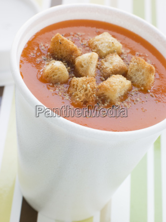 cup of tomato soup with croutons