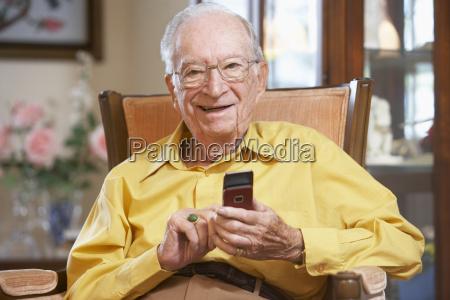 senior man text messaging