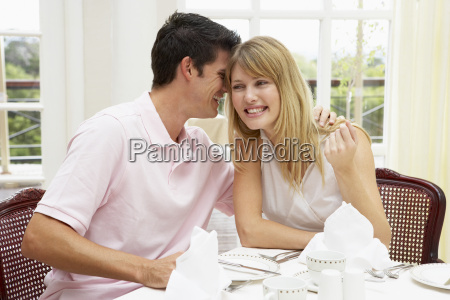 young couple enjoying hotel meal