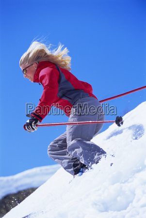 skier coming down snowy hill selective
