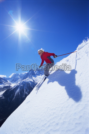 skier coming down snowy hill smiling