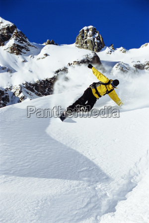 snowboarder coming down snowy hill