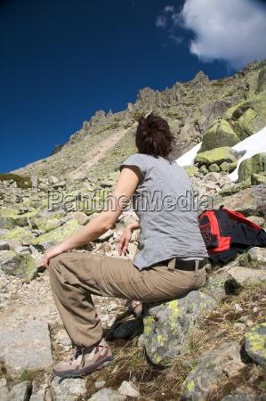 woman resting between rocks