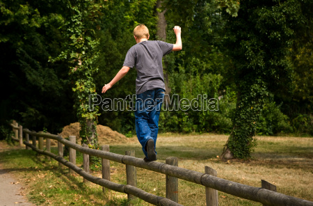 balance on a wooden fence