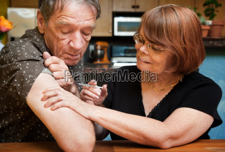 man and woman with small hypodermic