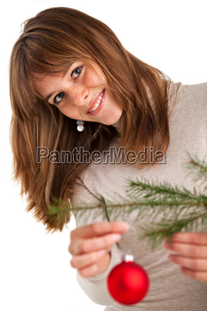pretty young woman decorates a christmas
