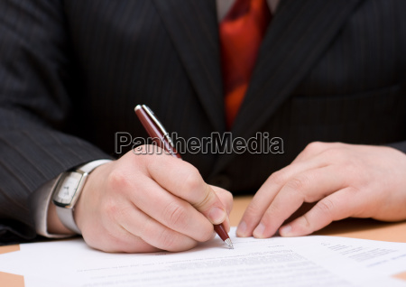businessman signing the agreement