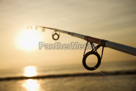 fishing pole at sunset