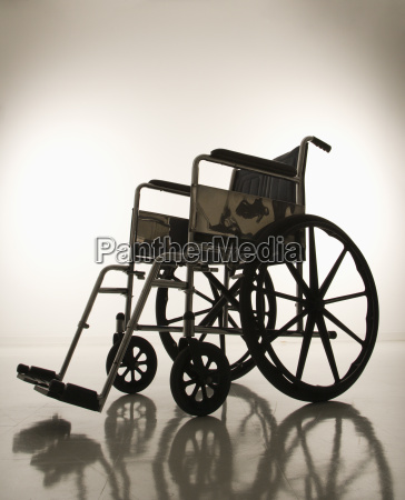 empty silhouetted wheelchair