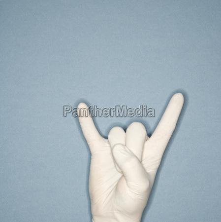 rubber gloved hand gesture