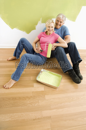 happy couple with painting utensils