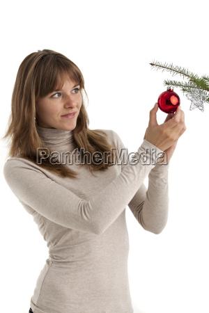 young woman with christmas tree ball