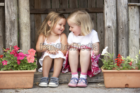 two young girls playing in wooden