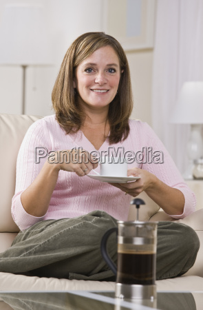 woman drinking coffee from french press