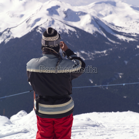 skier overlooking the mountains