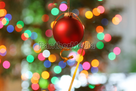 red frosted christmas ornament with colorful