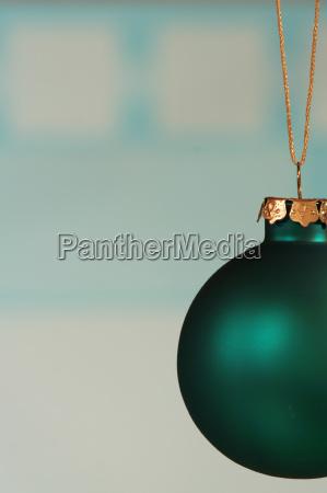 teal green ornament on light blue