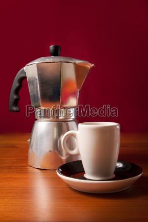 espresso cup and coffee percolator