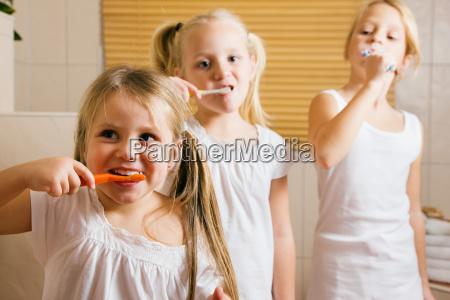 evening routine brushing teeth sisters