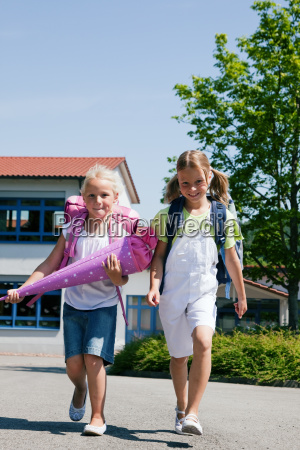 two schoolchildren having fun