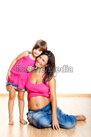 pregnant woman with her daughter