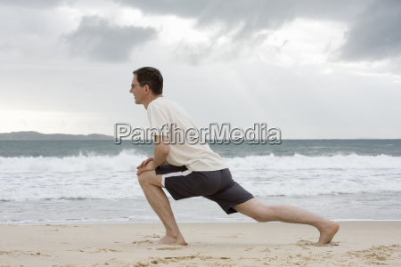 man making stretching exercises on the